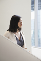 Asian businesswoman standing in office