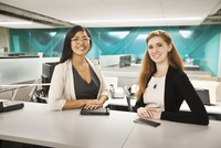 Businesswomen smiling in office