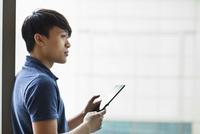 Asian businessman using digital tablet in office