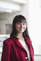 Hispanic businesswoman smiling in office