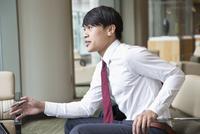 Asian businessman talking in office lounge