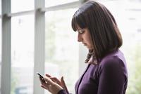 Hispanic woman using cell phone