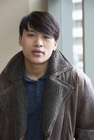 Asian man wearing fleece coat