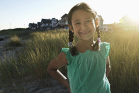 Caucasian girl smiling on beach