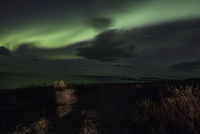 Northern lights over remote landscape