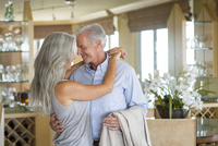 Older Caucasian couple hugging