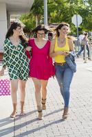 Hispanic women walking outdoors