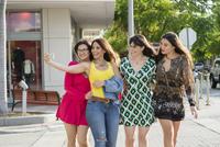 Hispanic women taking selfie outdoors