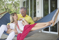 Older Caucasian couple laying in hammock