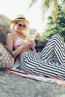 Caucasian woman using cell phone outdoors