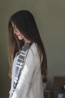 Caucasian woman standing indoors