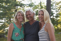 Caucasian mother and daughters smiling outdoors
