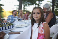 Caucasian girl smiling at outdoor table