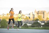 Caucasian women jogging outdoors