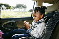 Black girl sitting in car seat