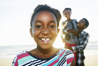 Black girl smiling on beach
