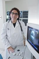 Hispanic doctor examining sonogram in hospital