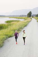 Caucasian women jogging on rural road