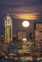 Moon and high rise buildings over Seattle waterfront, Washington, United States
