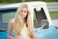 Caucasian woman standing near truck