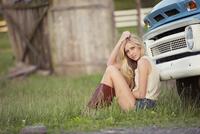 Caucasian woman sitting near truck