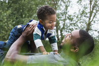 African American father and son playing outdoors