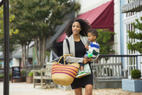 African American mother carrying son outdoors