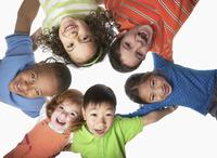 Children hugging in a circle