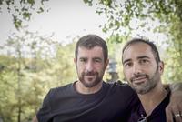 Caucasian gay couple hugging outdoors