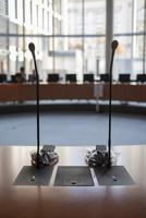 Microphones at desk in meeting room