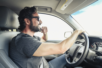 Hispanic man driving car