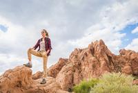 Hispanic woman standing on mountain