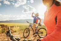 Hispanic couple riding bikes on remote trail