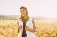 Hispanic woman smiling in remote field