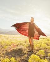 Hispanic woman standing in remote field