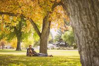 Hispanic couple relaxing in park