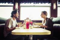 Hispanic couple eating breakfast in diner