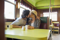 Hispanic couple kissing in diner