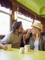 Hispanic couple talking in diner