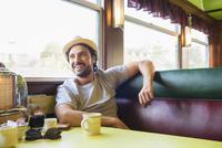 Hispanic man smiling in diner