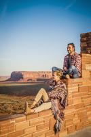 Hispanic couple admiring remote desert