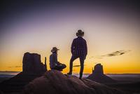 Hispanic couple admiring desert landscape at sunset
