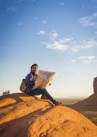 Hispanic man reading map in remote desert