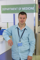 Caucasian man with Down Syndrome working in hospital