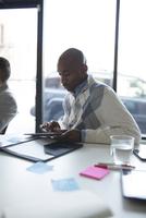 Businessman using digital tablet in office meeting