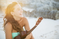 Hispanic teenage girl holding ukulele