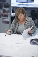 Businesswoman writing notes in office