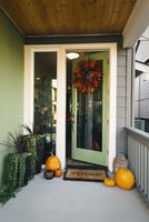 Pumpkins and wreath in doorway