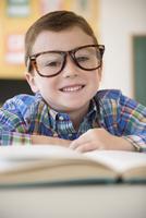 Caucasian student wearing eyeglasses in classroom