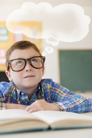 Caucasian student with thought bubble in classroom
